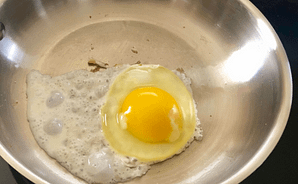 Fried Egg in Stainless Skillet