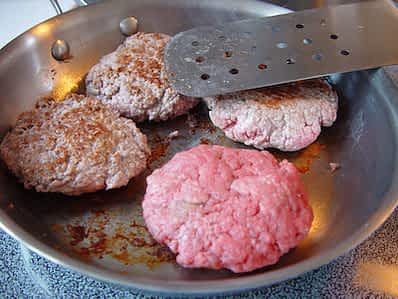Hamburgers in a frying pan