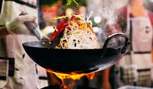Carbon steel wok with stir fry and fire