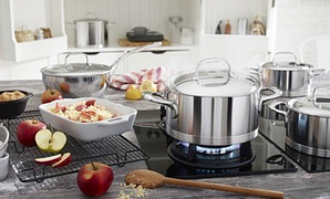 Demeyere Atlantis on stove - Top 5 Brands of Clad Stainless Cookware (And Why You Should Buy Stainless)